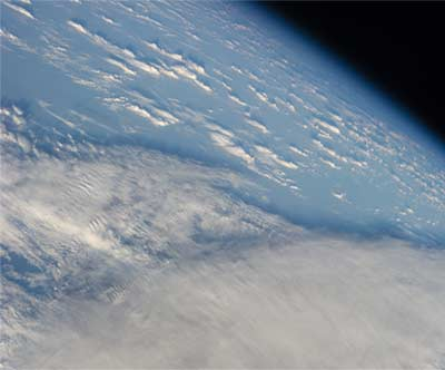 Earth's Horizon and Clouds Over the South Pacific Ocean
